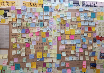Taiwan deports Chinese tourist who tore down Hong Kong posters