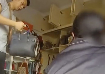Chinese fake goods seller snared by mother's 'LV' shopping bag
