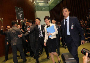 Chaos again in Hong Kong legislature as Carrie Lam is heckled by lawmakers