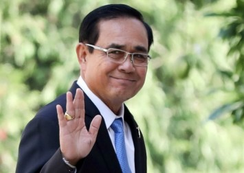 Thai PM warns protesters not to defy ban, threatening to 'use the law'