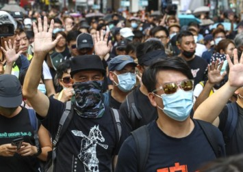 Hong Kong judge jails trio over 'savage' attacks on bystanders during protests