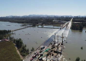 13 dead after bus runs off flooded bridge into river in northern China