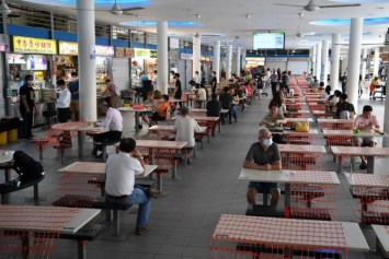 Covid-19 vaccination status at hawker centres, coffee shops to be checked by hawkers