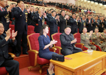 Kim Jong-un's stylish wife makes surprise appearance at party celebrating nuclear achievements