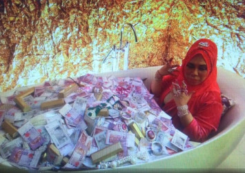 Malaysian beauty tycoon draws flak for showing herself in bathtub filled with money