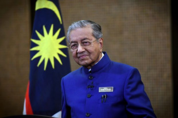 Dr Mahathir jokes that Malaysia's new retirement age is 95