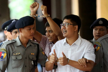 Myanmar judge jails Reuters reporters for 7 years in landmark secrets case