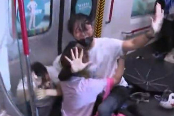 Police chase protesters into MTR station and beat people on train