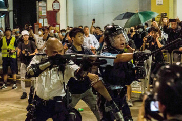 Officer who pointed gun at Hong Kong protesters is featured on China news show