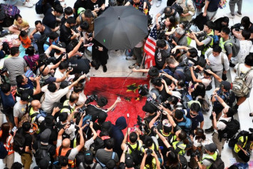 Victim of Hong Kong radical protesters says he does not regret patriotic stance