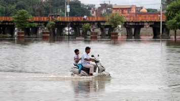 Floods kill 113 in north India in late monsoon burst, jail and hospital submerged