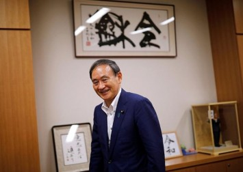 Japan's Suga in pole position for PM as debate kicks off