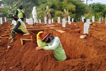 Burying his anguish: Indonesian gravedigger lays to rest dozens of Covid-19 victims each day