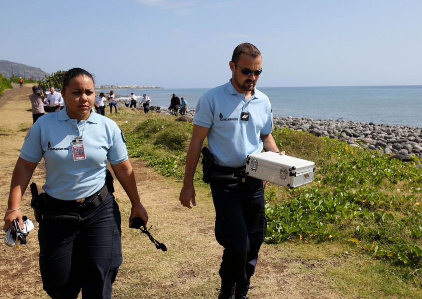 No plane link to new debris in island hunt for MH370 clues