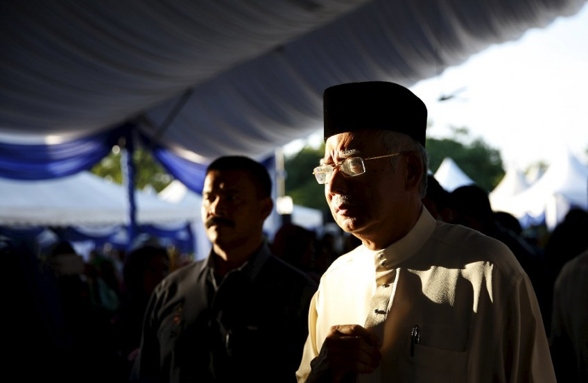 Malaysia's opposition demands emergency debate on PM after graft allegations