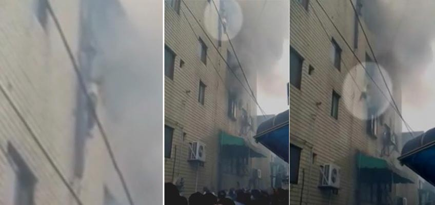 Harrowing moments as woman throws 3 kids down from burning building in Korea
