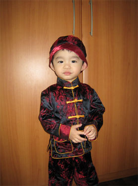 red chinese costume dragon boy preparing for lunar new year celebration in school - Chinese New Year Outfit